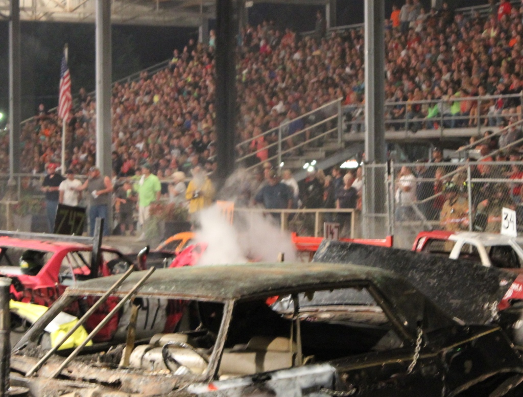 Smoke rises, and can be seen throughout the fairgrounds.