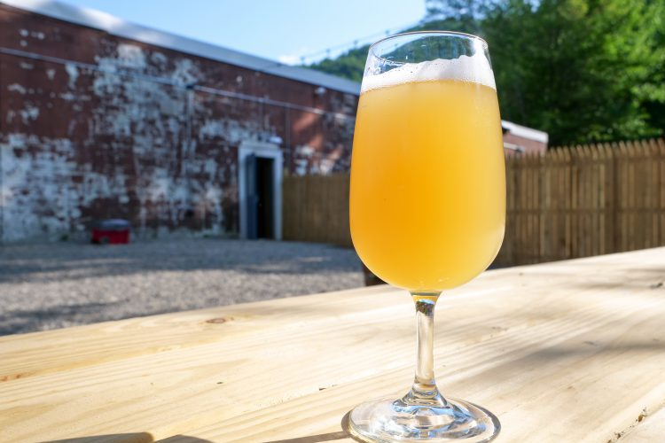 'Prasmatic Light', a refreshing wheat ale with notes of orange peel, peaches and grapefruit. @Rebecca Andre of Mountain Girl Photography, NY. Use by permission only please.