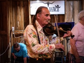 Earl Pardini (of the Slide Mountain String Band) also called dances while fiddle playing